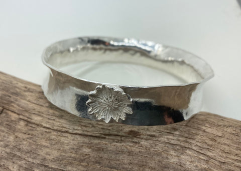Anticlastic  silver bangle with a poppyhead
