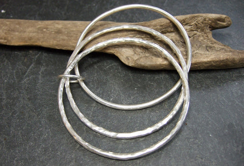 Triple textured joined bangles