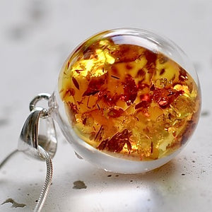 Resin sterling silver necklace with amber