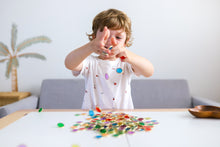 Load image into Gallery viewer, Metal Rimmed Counting Chips for counting, sensory and creative play with child playing and dropping counting chips on table