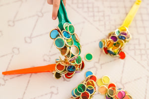 Colourful magnetic wands and metal rimmed counting chips used by children for sensory play