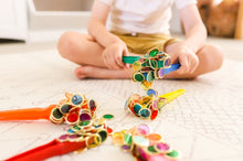 Load image into Gallery viewer, Colourful magnetic wands and metal rimmed counting chips used by children for sensory play