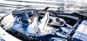 Luxury black and white power boat focusing on the interior with a custom audio system with speakers.
