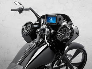 Custom black Harley Davidson motorcycle highlighting handlebars with custom screen with audio system.
