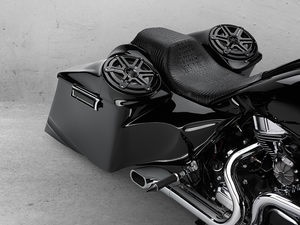 Back of the all black Harley featuring speakers set in the rear of the bike next to the seat.
