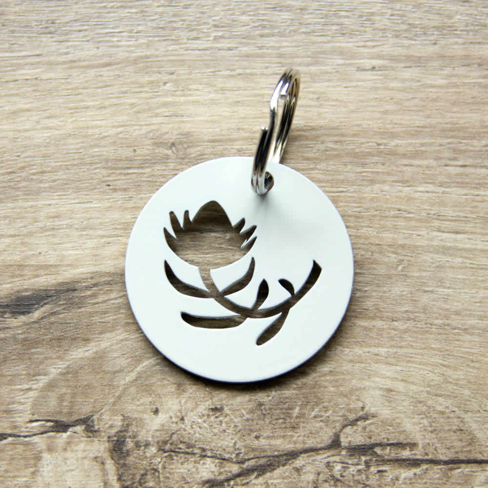 white protea flower metal keyring