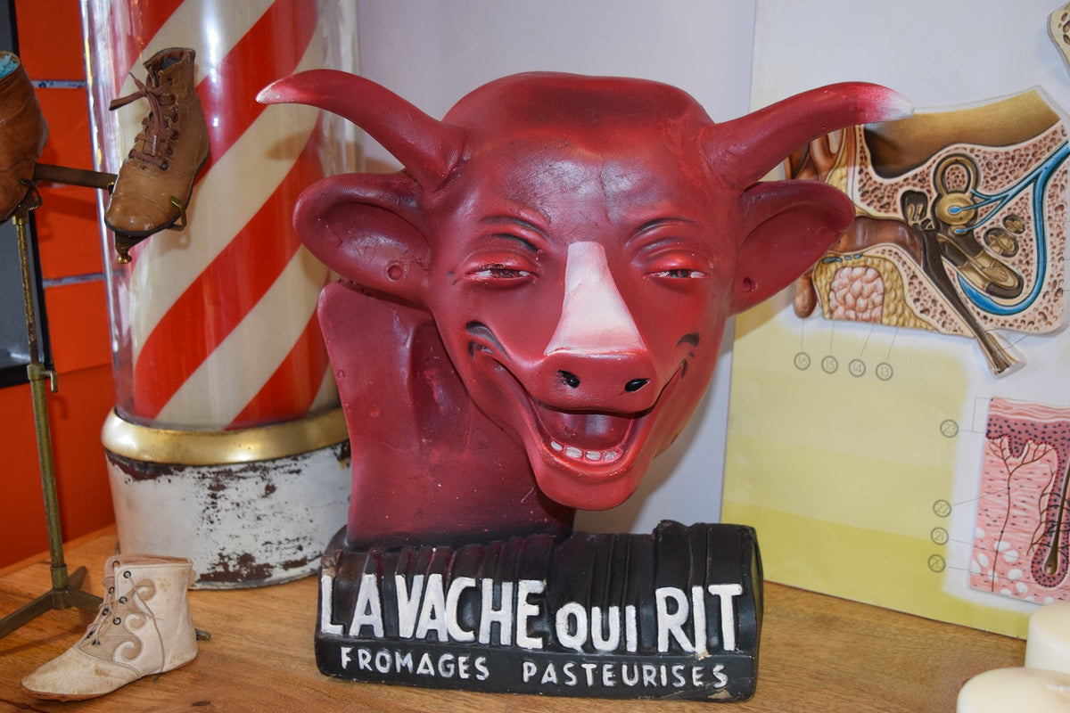 Unusual plaster advertising figure of the Laughing Cow (La Vache qui Rit)