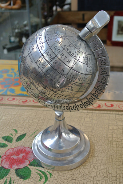 Aluminium globe depicting naive illustration of countries