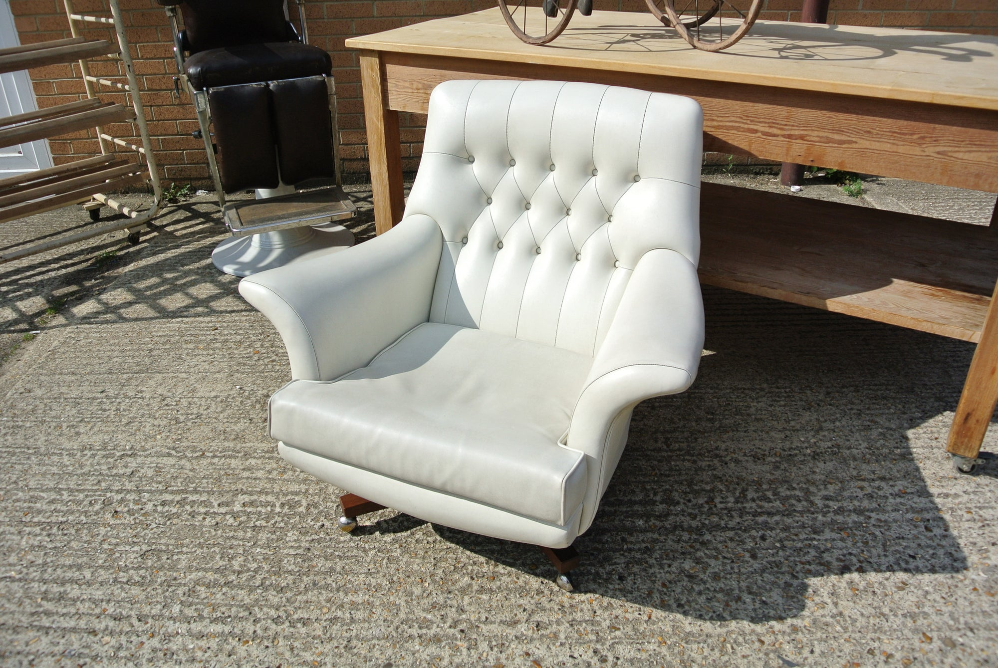 1960s G-Plan white leatherette revolving chair