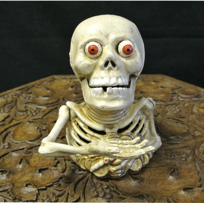 Mechanical skull money box