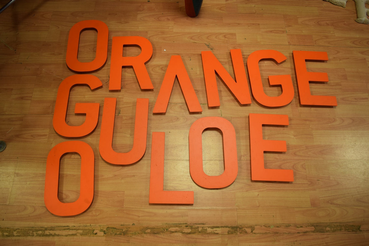Orange Plastic Letter A or V
