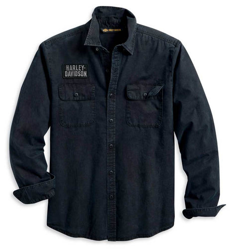 Harley-Davidson® Men's Motorcycle Slim Fit Woven Shirt - Black. Made from 100% cotton twill. Enzyme and stonewashed for softness and a lived-in look. Snap-down collar. Button front and cuffs. Button flap chest pockets. Embroidered patch and 1903 accent. Flocked and printed graphics. Slim fit, fits closer to the body. 96110-20VM.