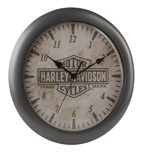 Harley-Davidson® Core Trademark Bar & Shield Clock, HDX-99105.  Trademark logo on antiqued face. Continuous sweep AA battery operated clock movement. Plastic frame with oil-rubbed bronze finish. (Battery not included.)