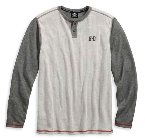 Harley-Davidson® Men's Double Knit Henley, 96407-18VM. Made of 60% cotton and 40% polyester double knit pointel jersey that is washed for softness. Button placket. Contrasting sleeves, neck trim, and placket is reverse side of fabric. Contrasting stitching. Flocked graphics on left chest and back.