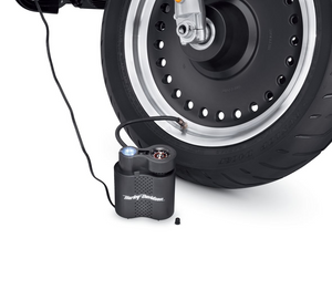 Harley-Davidson® Compact Air Compressor with Light -  12700020.  Correct tire pressure is crucial to the safe operation and long tire life, but checking the pressure, finding a gas station with a working air pump, and filling the tire is a chore that many of us ignore. Harley-Davidson®'s Air Pump is designed to simplify this necessary procedure.