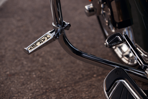 Harley-Davidson® Custom Harley Scripted Footpegs - 49102-86T.  These chrome-plated footpegs sport a gold-tone inlay of the Harley-Davidson® graphic.