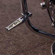 Load image into Gallery viewer, Harley-Davidson® Custom Harley Scripted Footpegs - 49102-86T.  These chrome-plated footpegs sport a gold-tone inlay of the Harley-Davidson® graphic.