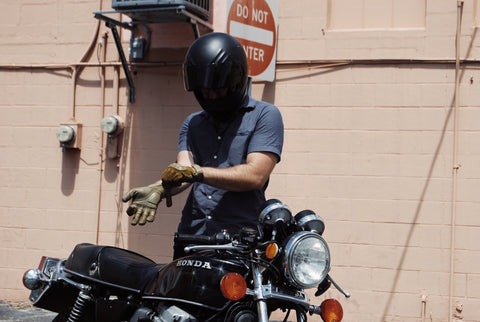Guy Putting on Motorcycle Gloves