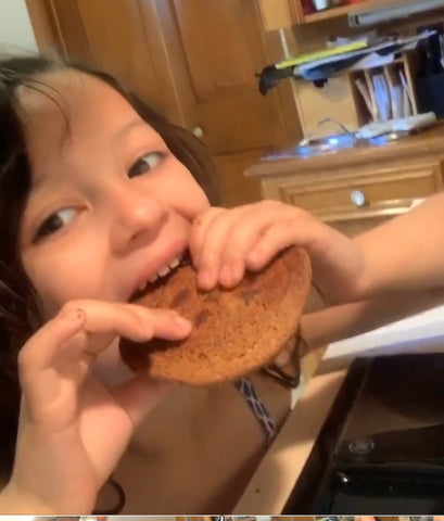 Evelyn eating cookie