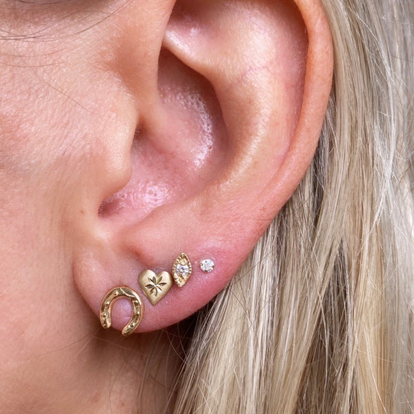 This ear Inspo features our favorite lucky charm. First the equestrian horse shoe studs, followed by the etched in my heart studs, then our noor stud that resembles an evil eye. Lastly our star dust studs as soon on Chrissy Teigen.