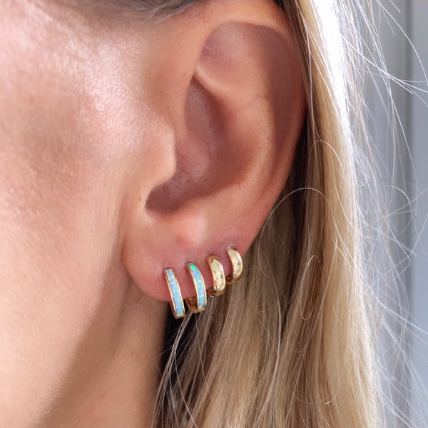 Our 14k gold & opal inlay huggie hoops are paired perfectly with our tiny biggie hoops.  These huggies are perfect for everyday effortless style.