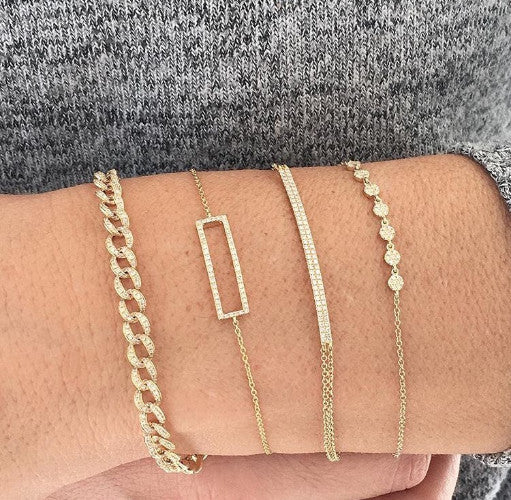 Four Stacked Gold and Diamond Bracelets