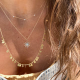 the sunburst diamond necklace is paired with our trots diamond necklace and the Sia talyor long random dots necklace