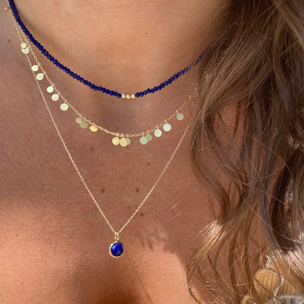 the enlightenment necklace is paired with the Sia Taylor random dots necklace and our three wishes necklace in lapis