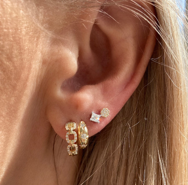 Our tiniest diamond disc studs pair perfectly with our princess cut diamond studs, the my sun & stars huggie hoops and the very special diamond chain link huggies.