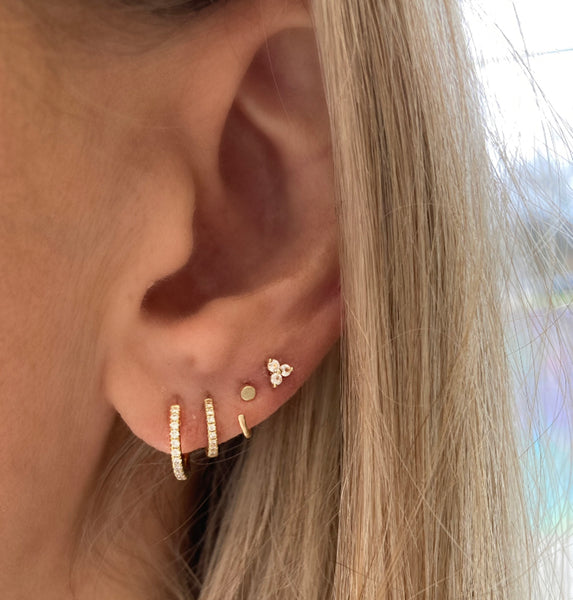 The tiniest huggie hoops look amazing with our Ava huggie hoops, the tiniest diamond huggie hoops and the sacred sapphire studs.