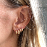 Two 14k gold little biggie hoops paired with the tiny biggie hoops. We recommend wearing them together, but can also be worn alone.