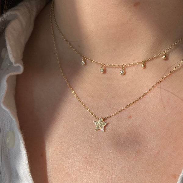 The pave diamond star necklace is pictured with the dew drop diamond station necklace.