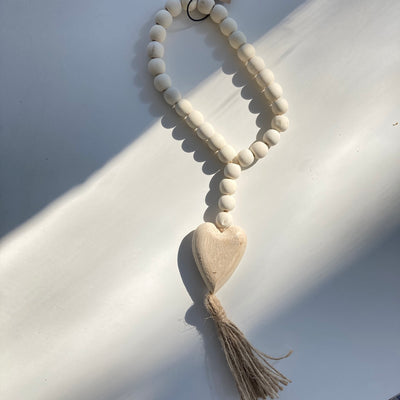 Wood Beads with Heart and Tassel at Katie Diamond in Ridgewood NJ