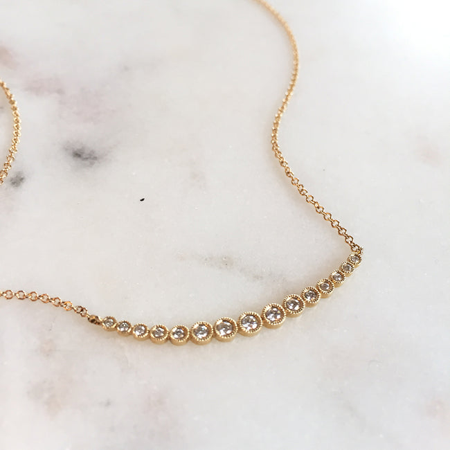 Curved Bezel Set Diamond Necklace with Graduating Size Diamonds