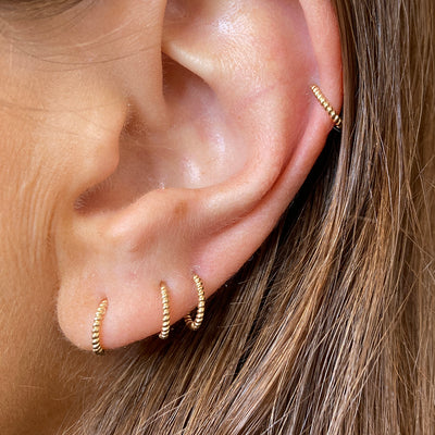 Four Gold Twisted Huggie Hoop Earrings