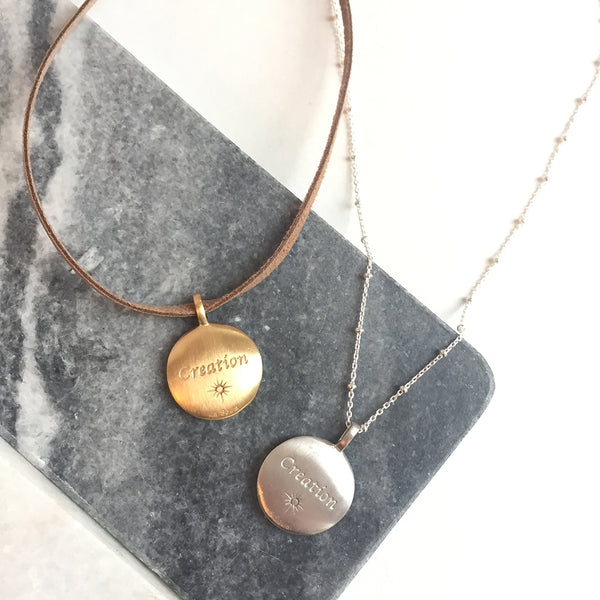 CREATION DISC NECKLACE