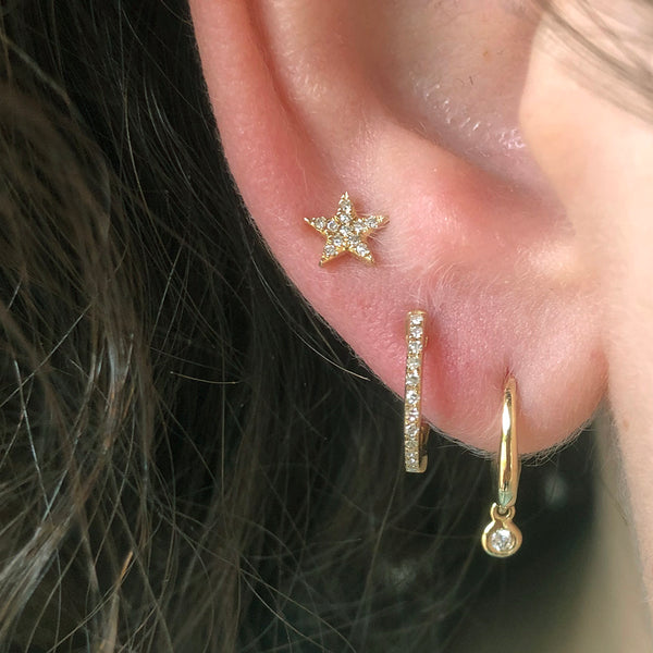 Three Gold and Diamond Studs and Huggie Hoops on Ear