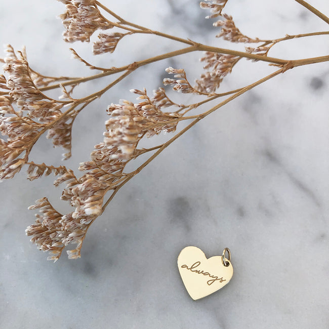 Gold heart charm engraved with always