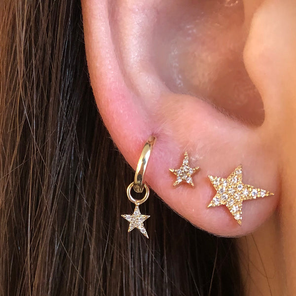 Three Different Diamond Star Earrings on Ear