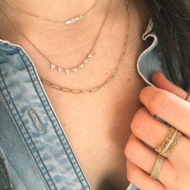 Layered Gold and Diamond Necklaces and Rings