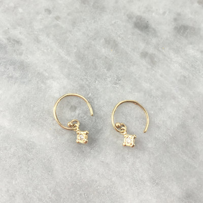 tiny gold diamond bezel drop earrings by Victoria Cunningham