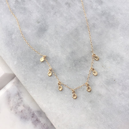 TINY DOTS ARC NECKLACE