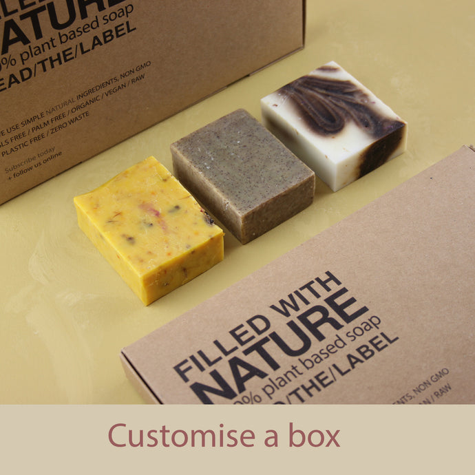 three handmade soaps with subscription recycled paper box
