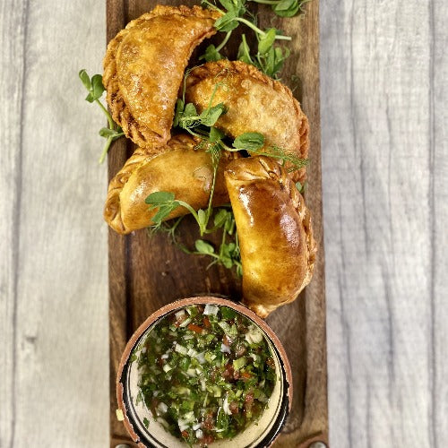 OCT STARTER FOR 2. Argentinian empanadas (meat or veggie) w/ roast garlic & herb aioli