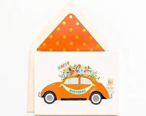 Happy Birthday pretty orange VW bug. Florals, cake and banner.
