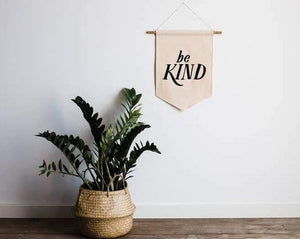 """Be Kind"" in black on cream canvas banner"