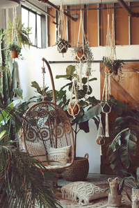 "24"" Beaded Plant Hanger displayed in boho room with swing chair, pillows and lots of plants!"