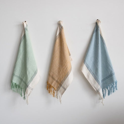 Sage Green, Light Mustard + Light Blue Fringe cotton tea towels hanging