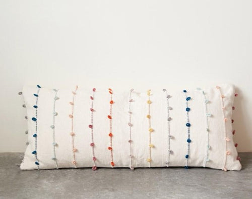 Decorate a bed or sofa with all over embroidered pillow. Featuring multi-colored embroidered. This rectangular pillow combines natural fabric with traditional patterns for a relaxed, elegant look.