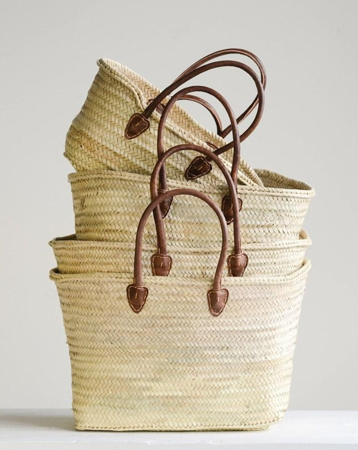 These Hand-Woven Moroccan Baskets w/ Leather Handles are perfection! Use for storage or the farmers market!